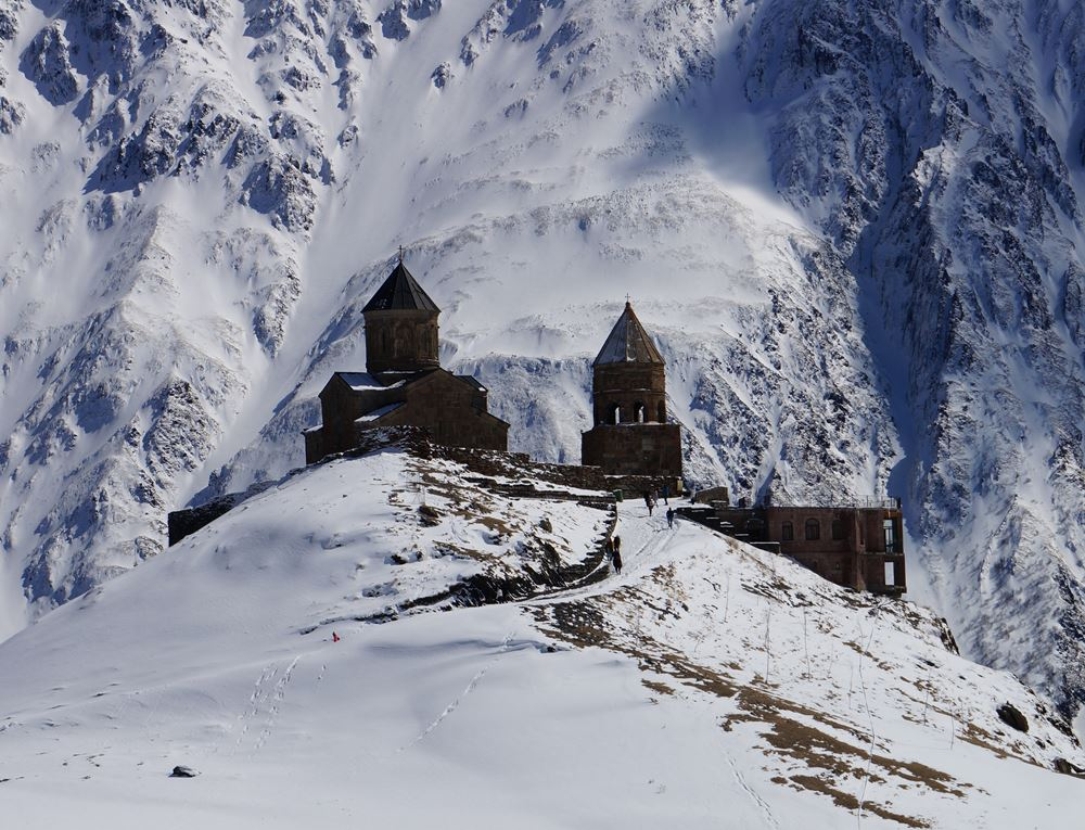 Gergeti Trinity Church against Mount Kazbegi, Georgia